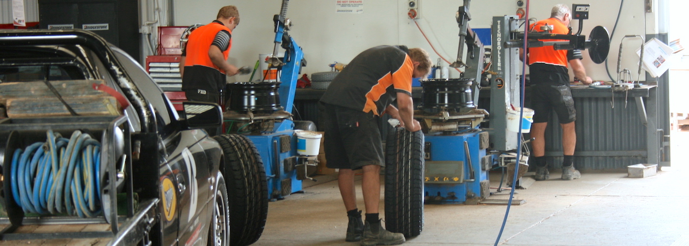 Workshop staff working on tyres